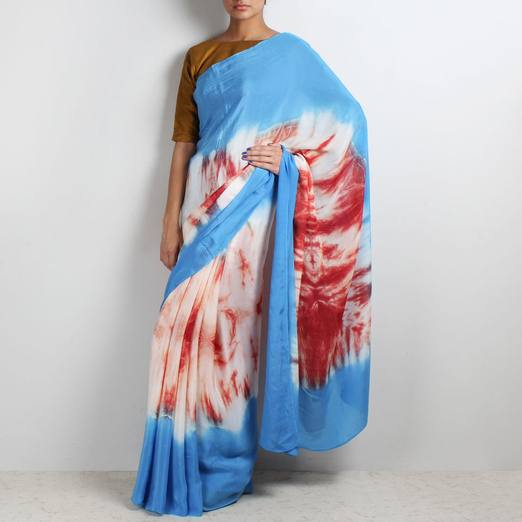 Rust - Blue Crepe Tie & Dye Saree by Marigold Weaves
