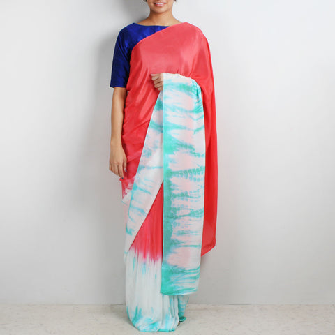 Coral Crepe Saree With Sea Green Tie & Dye Border by Marigold Weaves