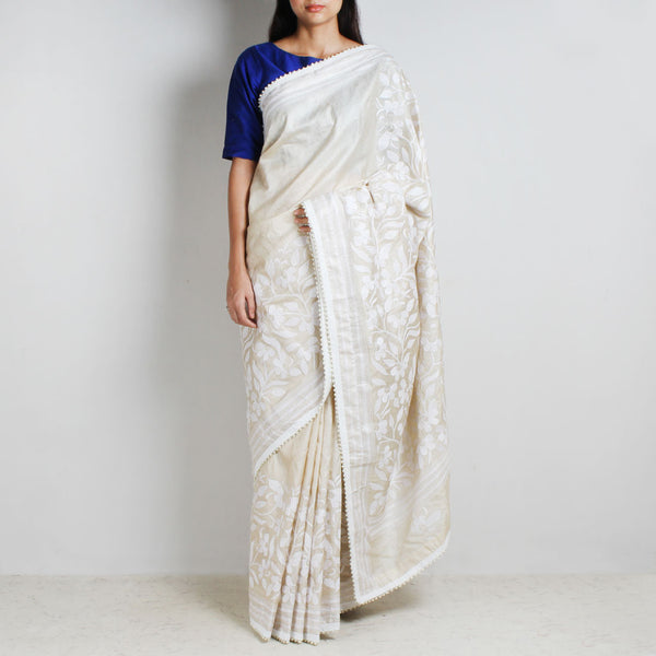 Beige Tussar Silk Sari With Kantha Floral Embroidery & Bead Finish by MEENAKARI
