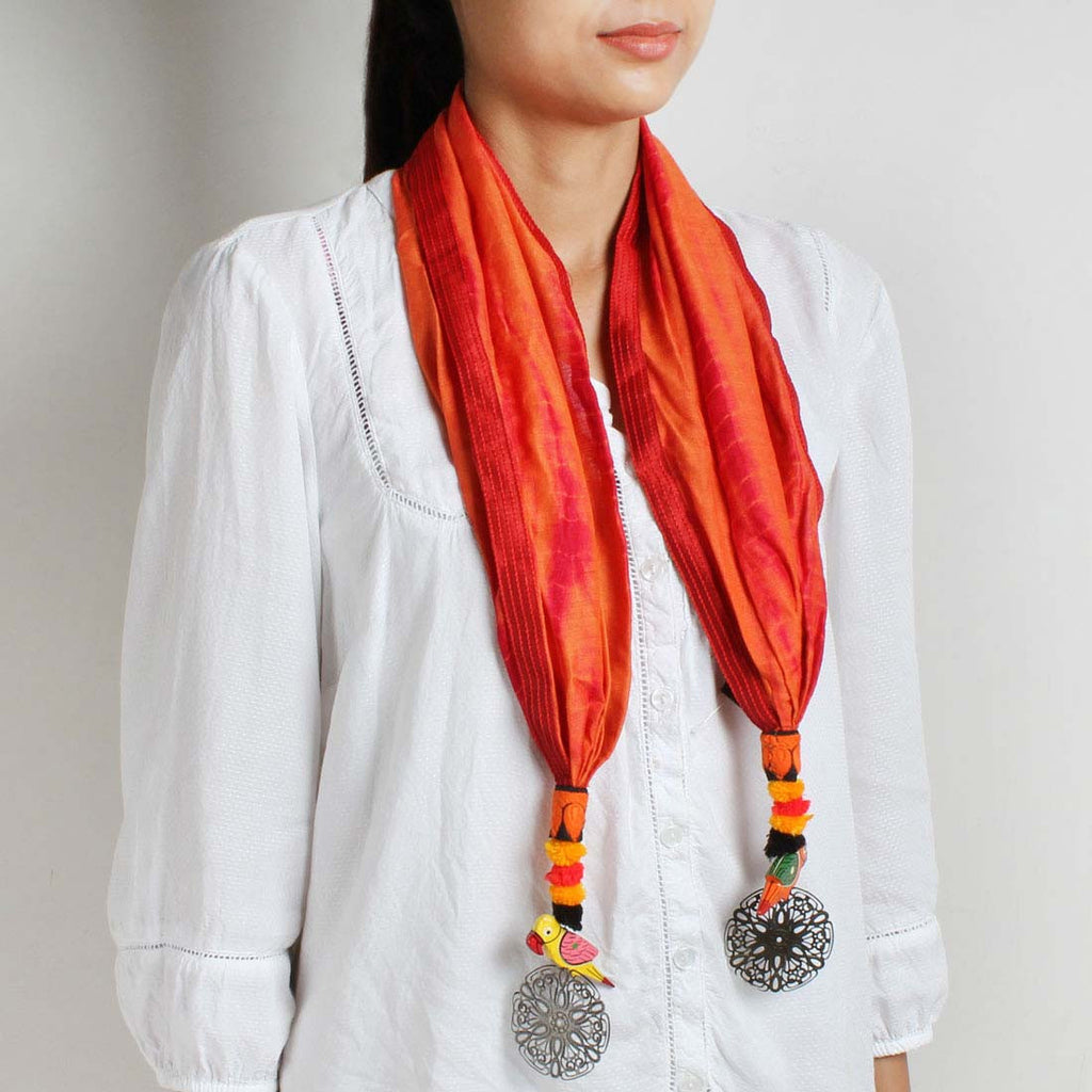 Orange Shibori Silk Stole With Parrot And Flower Tassels by MEENAKARI