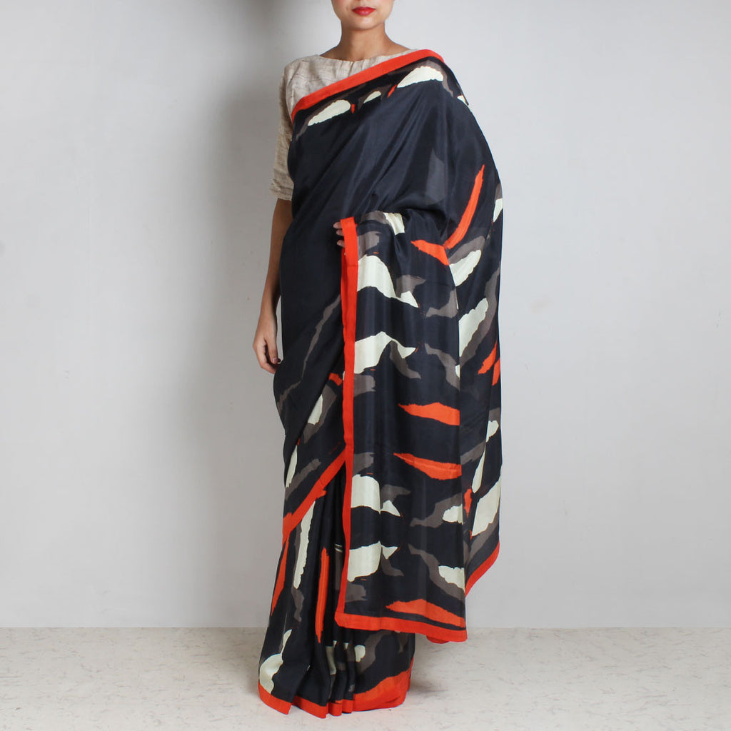 Black Abstract Gamer Print Silk Saree With Orange Contrast Border by NAKITA SINGH