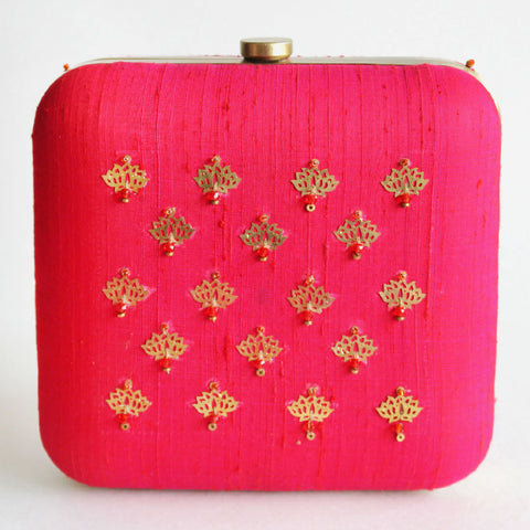 Pink Raw Silk Khadi Clutch With Lotus Motifs by Neonia