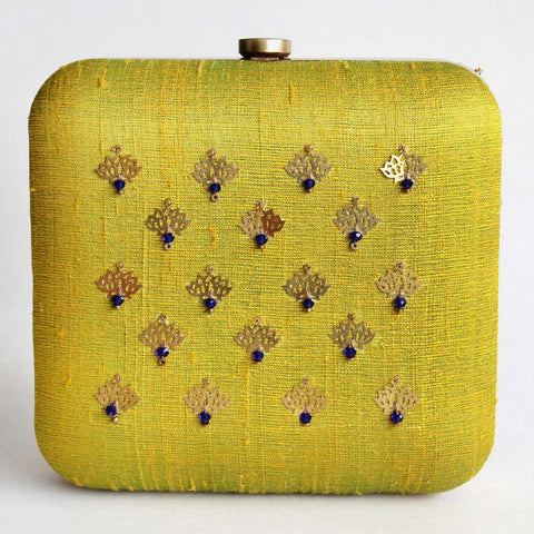 Yellow Raw Silk Khadi Clutch With Lotus Motifs by Neonia