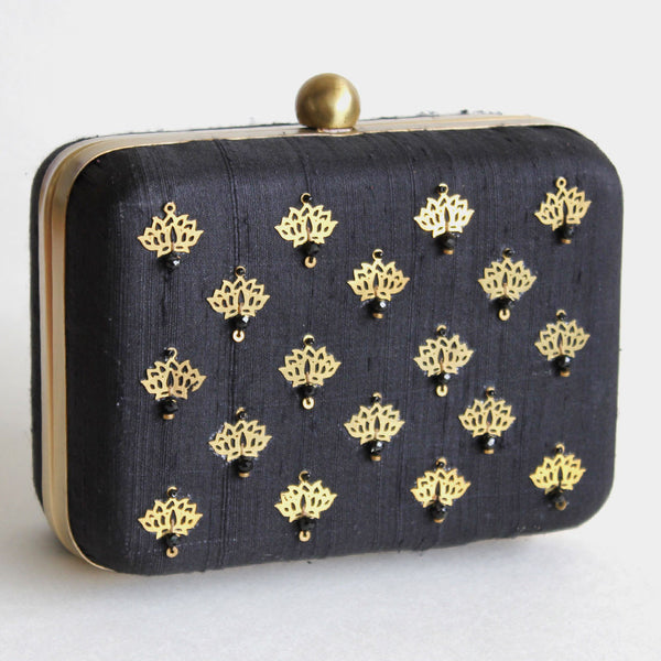 Black Raw Silk Khadi Clutch With Lotus Motifs by Neonia