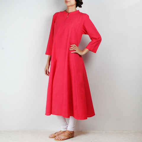 Flared red tunic with side cut by NOYA
