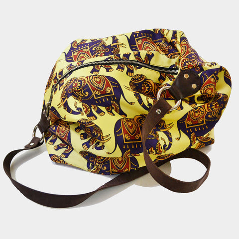 Yellow Elephant Poly Suede Jhola Bag by Noorani Biswas