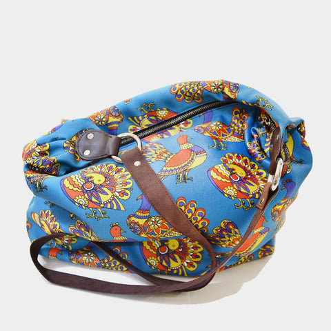 Blue Pigeon Poly Suede Jhola Bag by Noorani Biswas