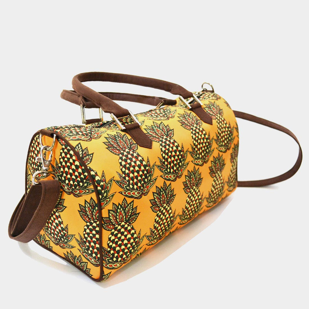 Yellow Pineapple Poly Suede Duffle Bag by Noorani Biswas