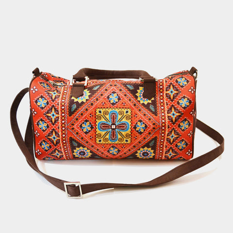 Red Kutch Poly Suede Duffle Bag by Noorani Biswas