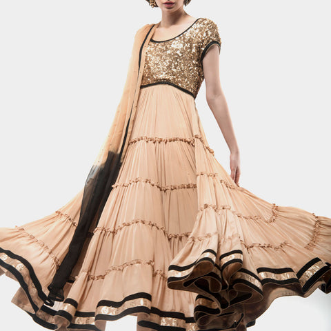 Beige flary multi tiered anarkali by SAMOR BY PRAGYA & MEGHA