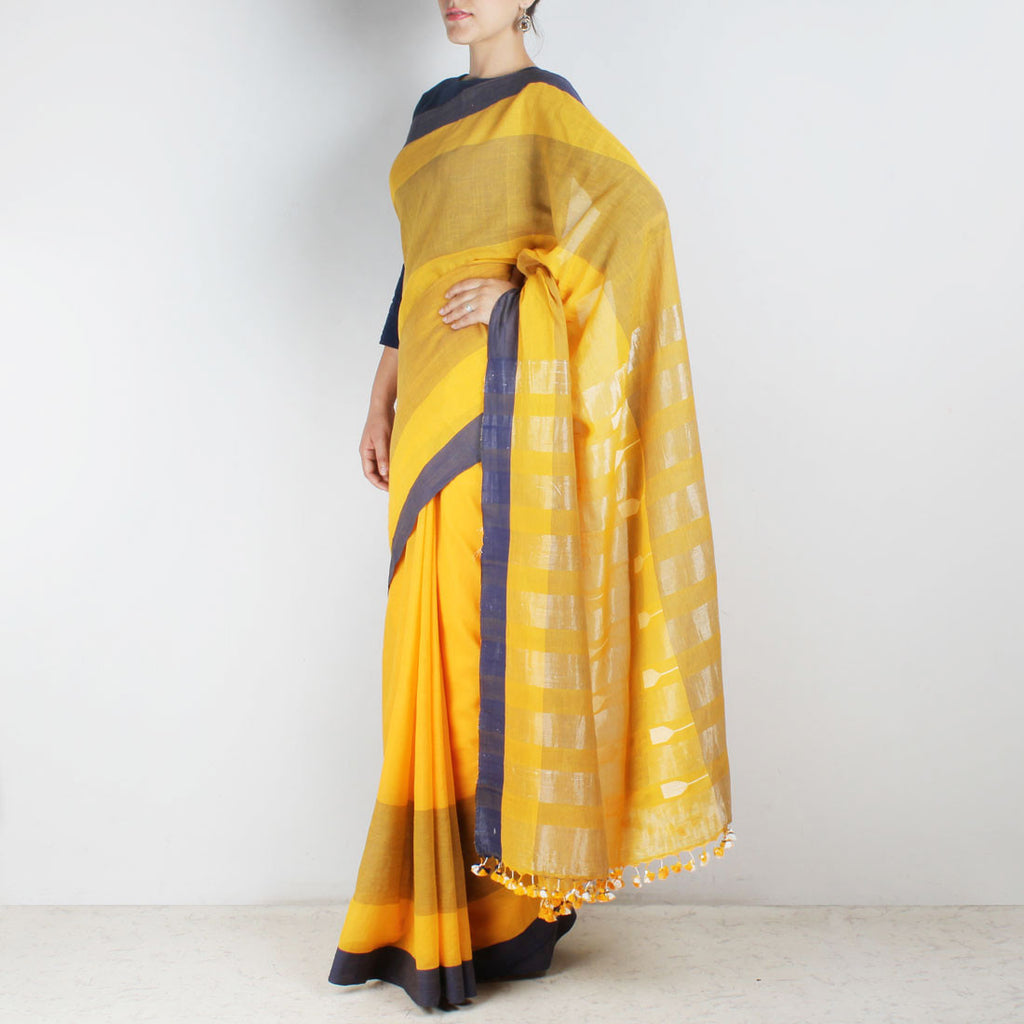 Handwoven Khadi Cotton Yellow Saree With Navy Blue Border by SSaha