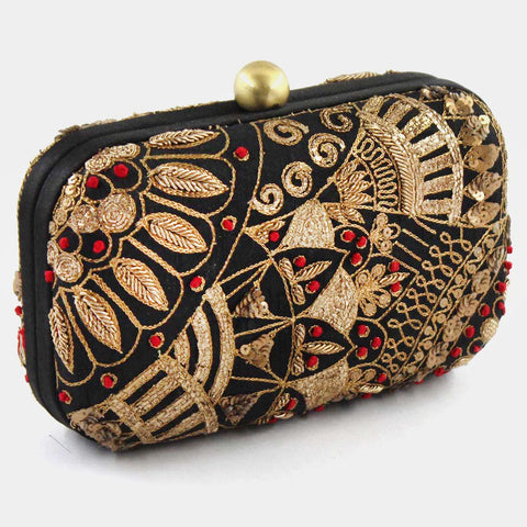Own this captivating clutch adorned with diligent mirrorwork. This structured box design has a top closure and features detachable chain strap. This one distinct & eye-catchy piece is crafted to titivate you on your much awaited occasions. by Tresor