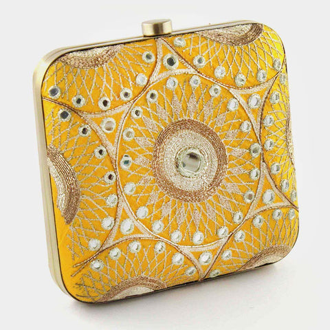 Yellow Hand Embroidered Silk Clutch With Mirrorwork by Tresor