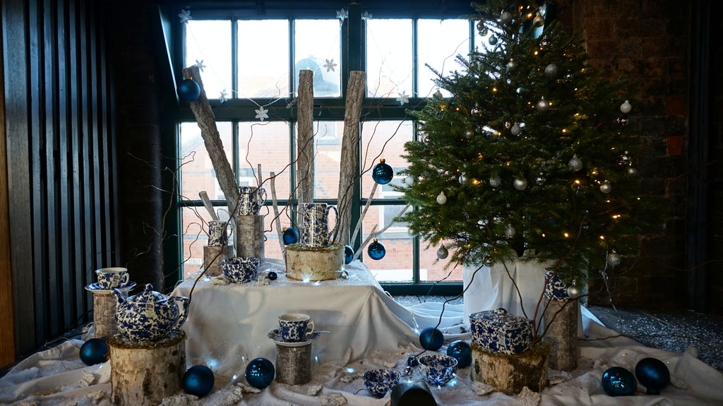 using white stippled logs and branches of silver burch to create height the display glistens with faux snow and a christmas tree adorned with festive - Christmas Decorations Factory Outlet