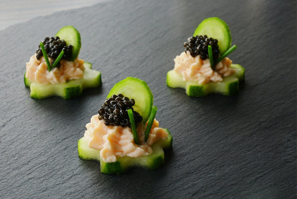 Fresh caivar canapés with cucumber and cream