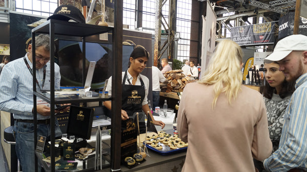 people and visitors are trying and tasting the products of Attilus Caviar