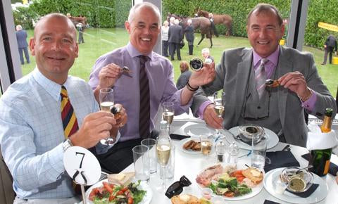 Three manly friends enjoying some caviar and champagne