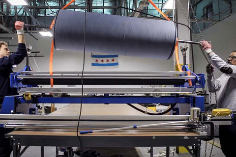 play a video that shows our process of making jeans from American materials, in Chicago.