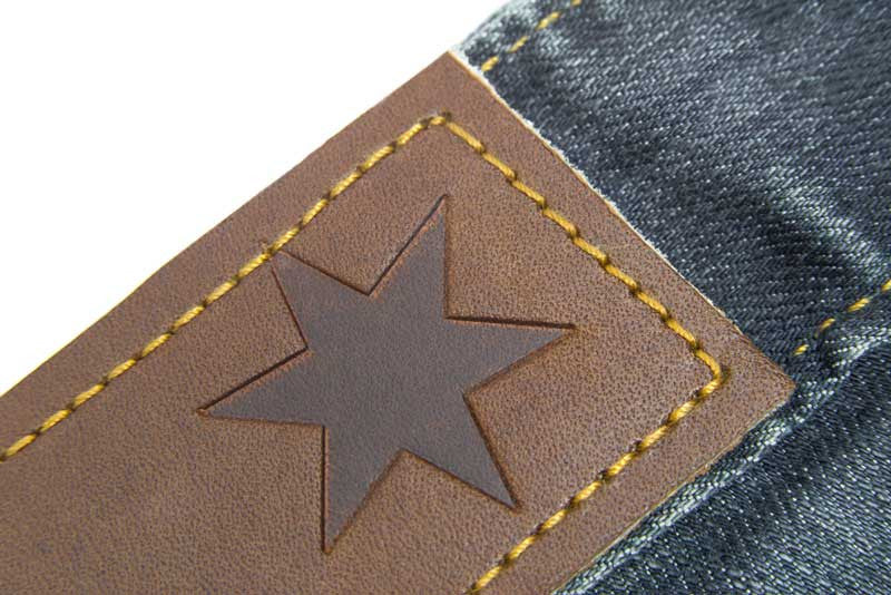 Tailored Fit Medium Wash Denim Jeans - Leather Patch Stamped With The Chicago Star