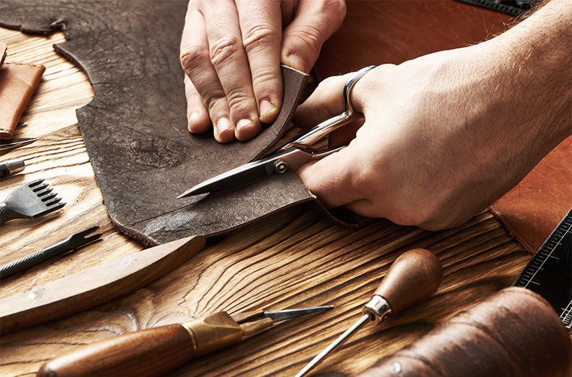 Cutting leather to make the wallets
