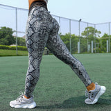 Anna Stripped Mesh and Elastic Waistband Workout and Yoga Leggings with Rouching.  Available in Animal Print and Black