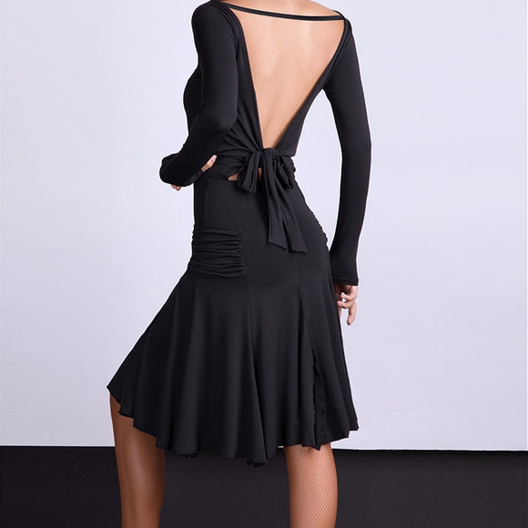 Black Latin Practice Dress with Open Back and Rouched Hips on Skirt. Long Sleeves and Tie Detail on Back Pra264