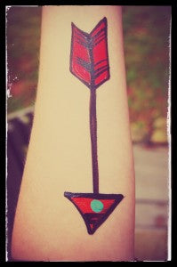 How to face paint a cool and quick arrow tattoo!