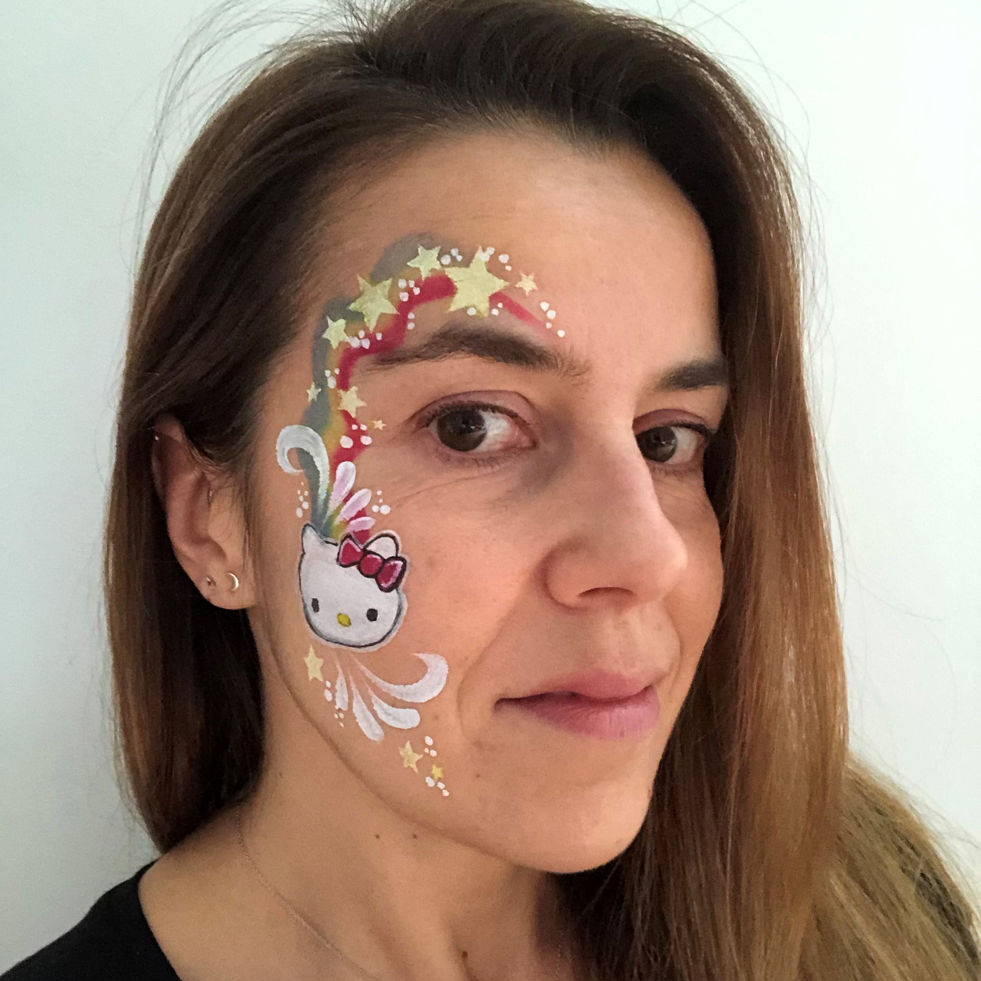 Hello Kitty Face Paint Design by Belén