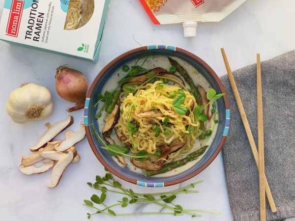 Miso Ramen Alfredo dish with ingredients and chopsticks
