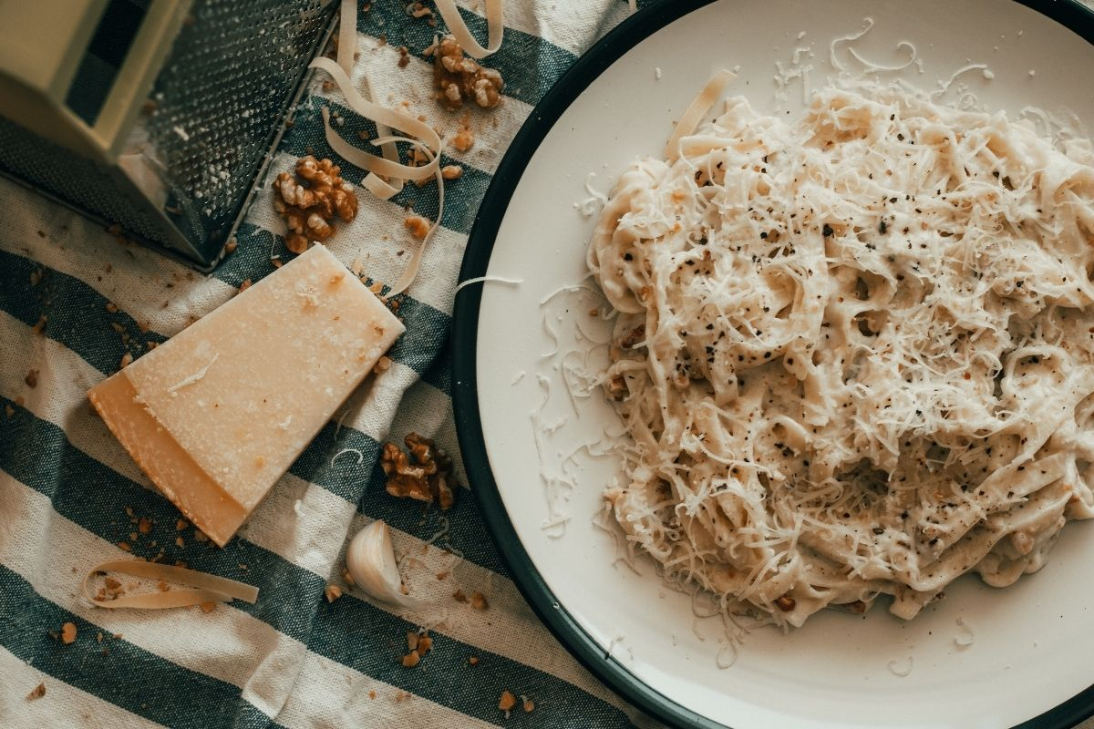 spaghetti carbonara with parmesan on blue blanket