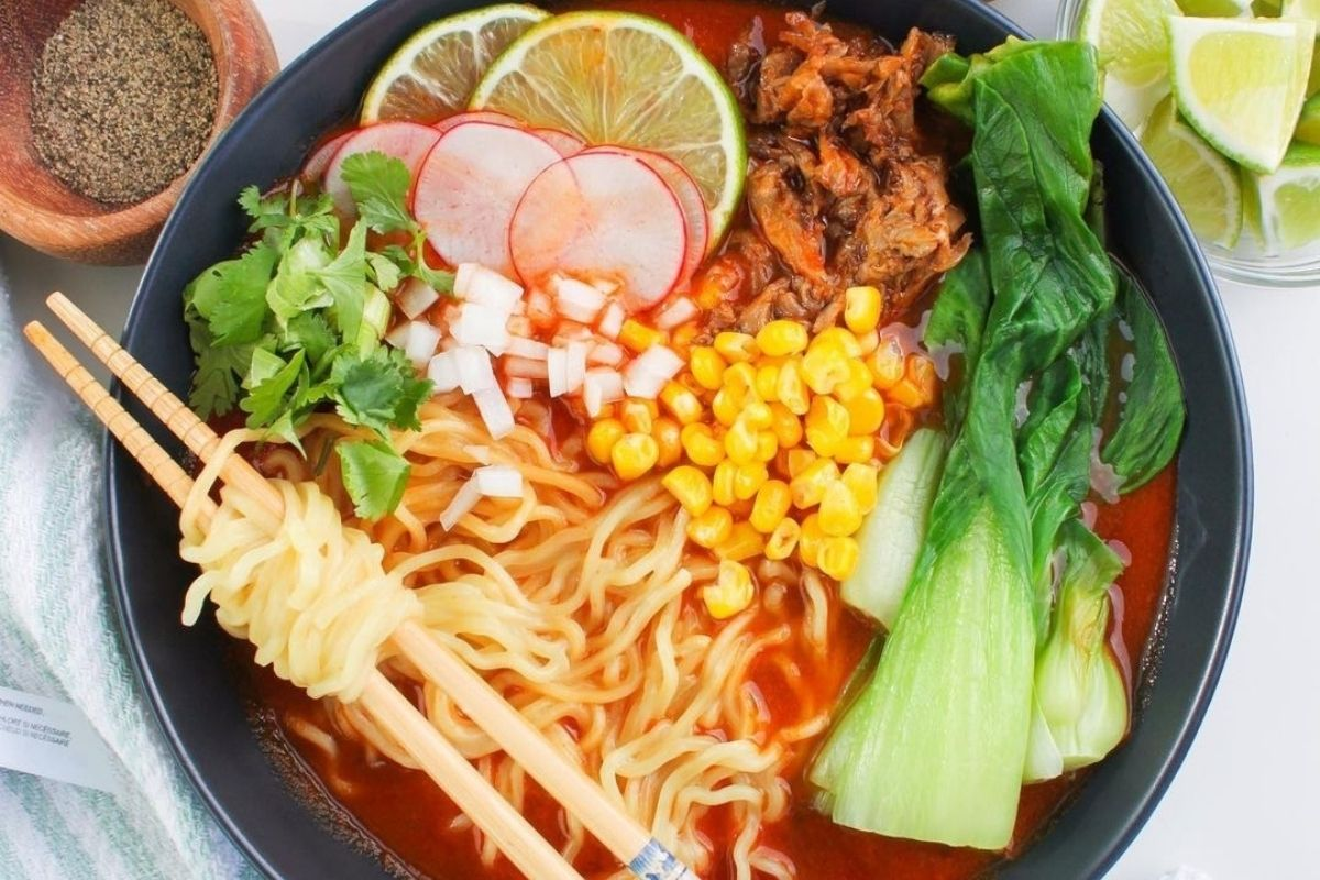 bowl of ramen topped with corn, radish, and more