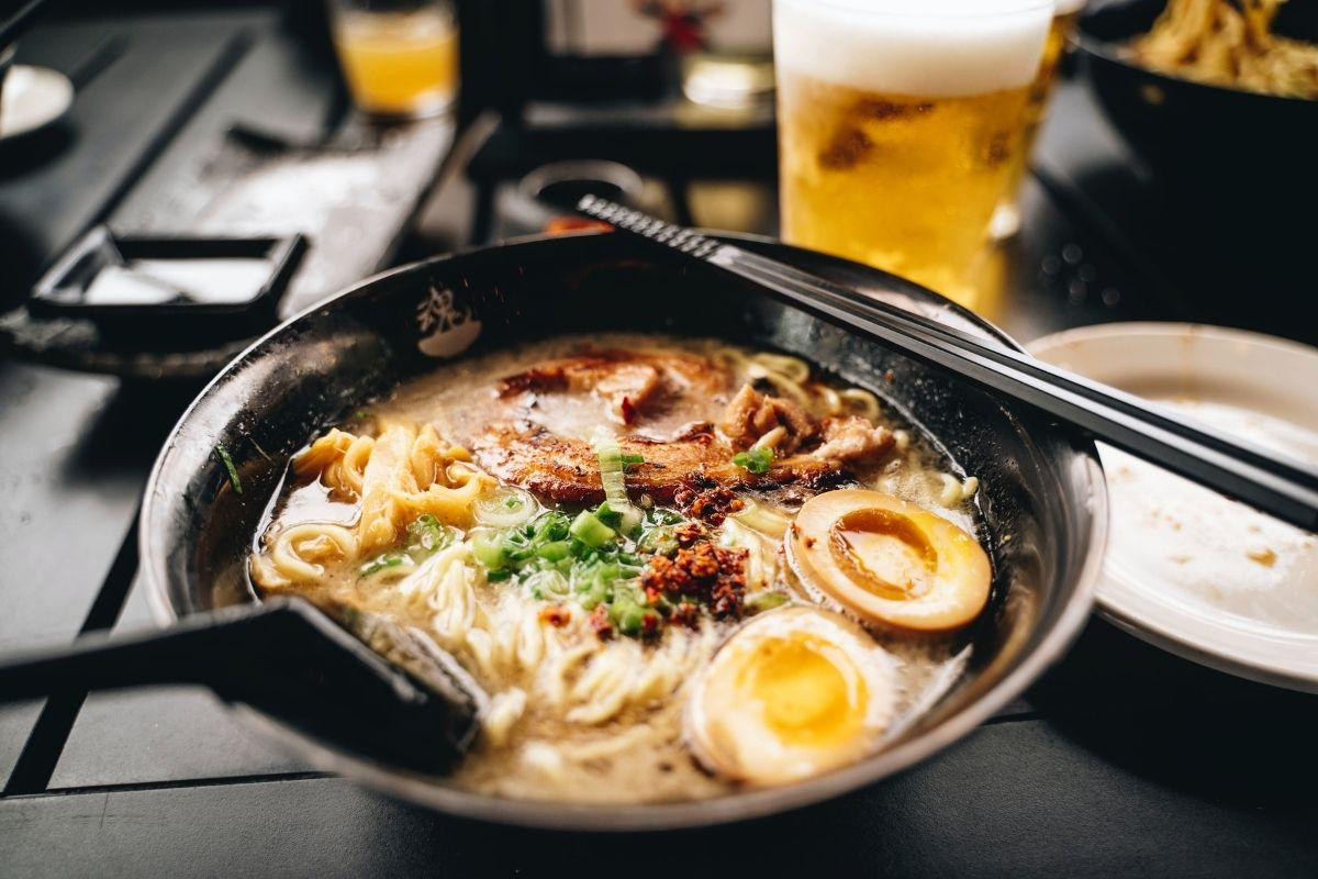 bowl of ramen and beer