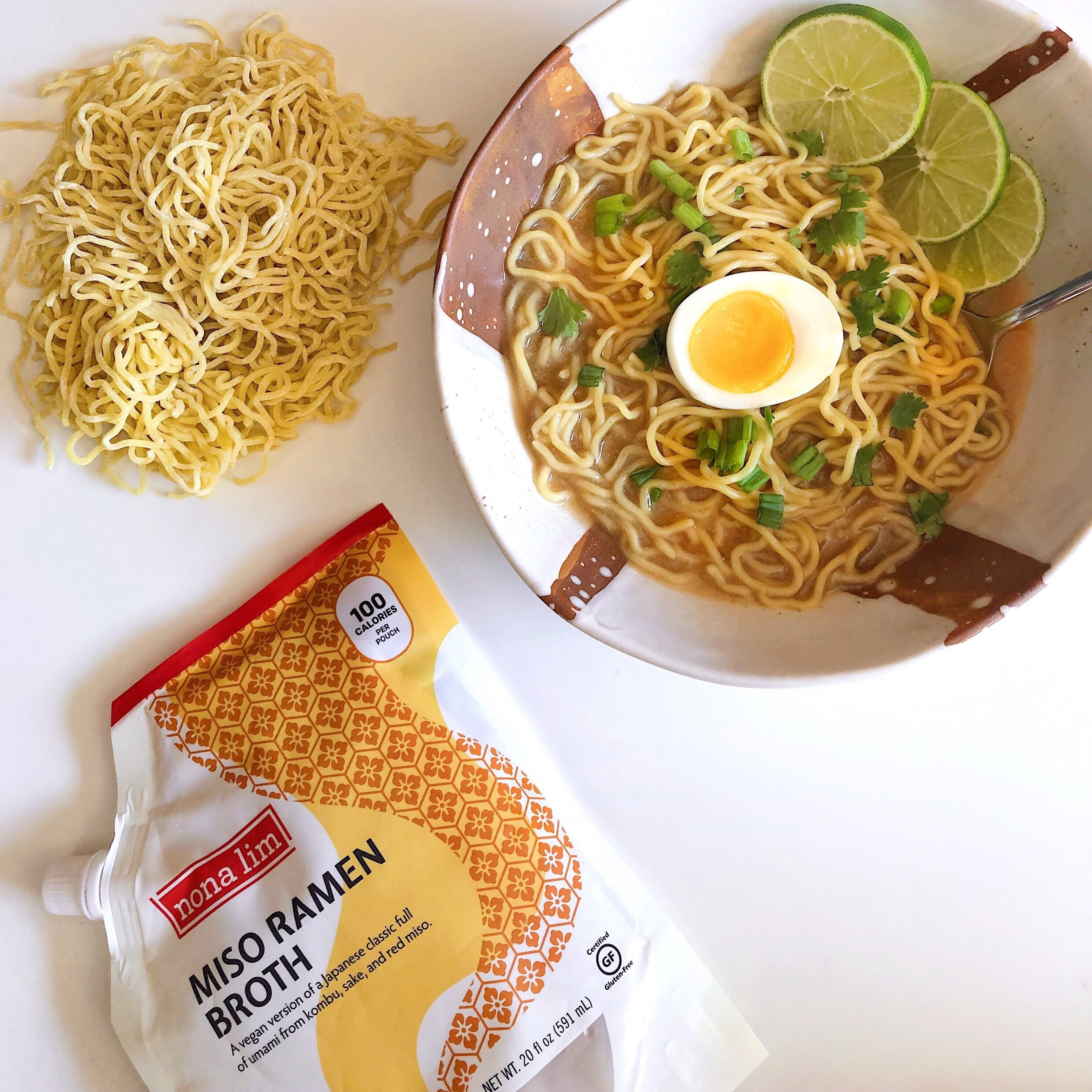 Nona Lim Miso Ramen Broth Pouch with bowl of ramen noodles and soft boiled egg