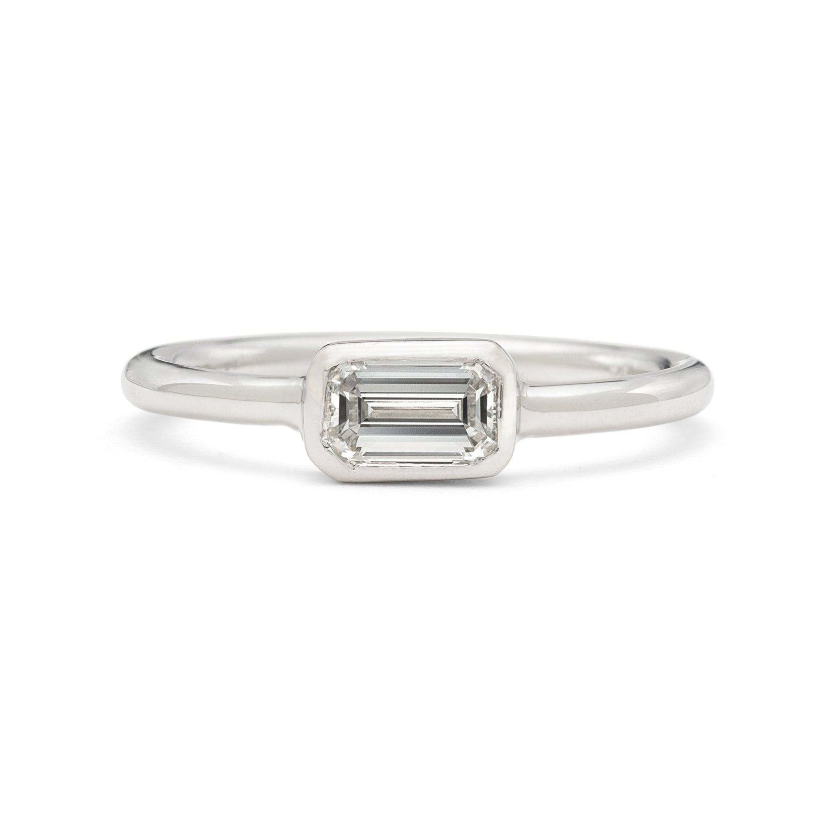 18kt White Gold Ring Featuring Horizontal Set Emerald Cut