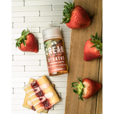 STRATUS E Liquid bottle on a cutting board with graham crackers and stawberries