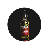 STRATUS E Liquid by Cream Vapor bottle with black background