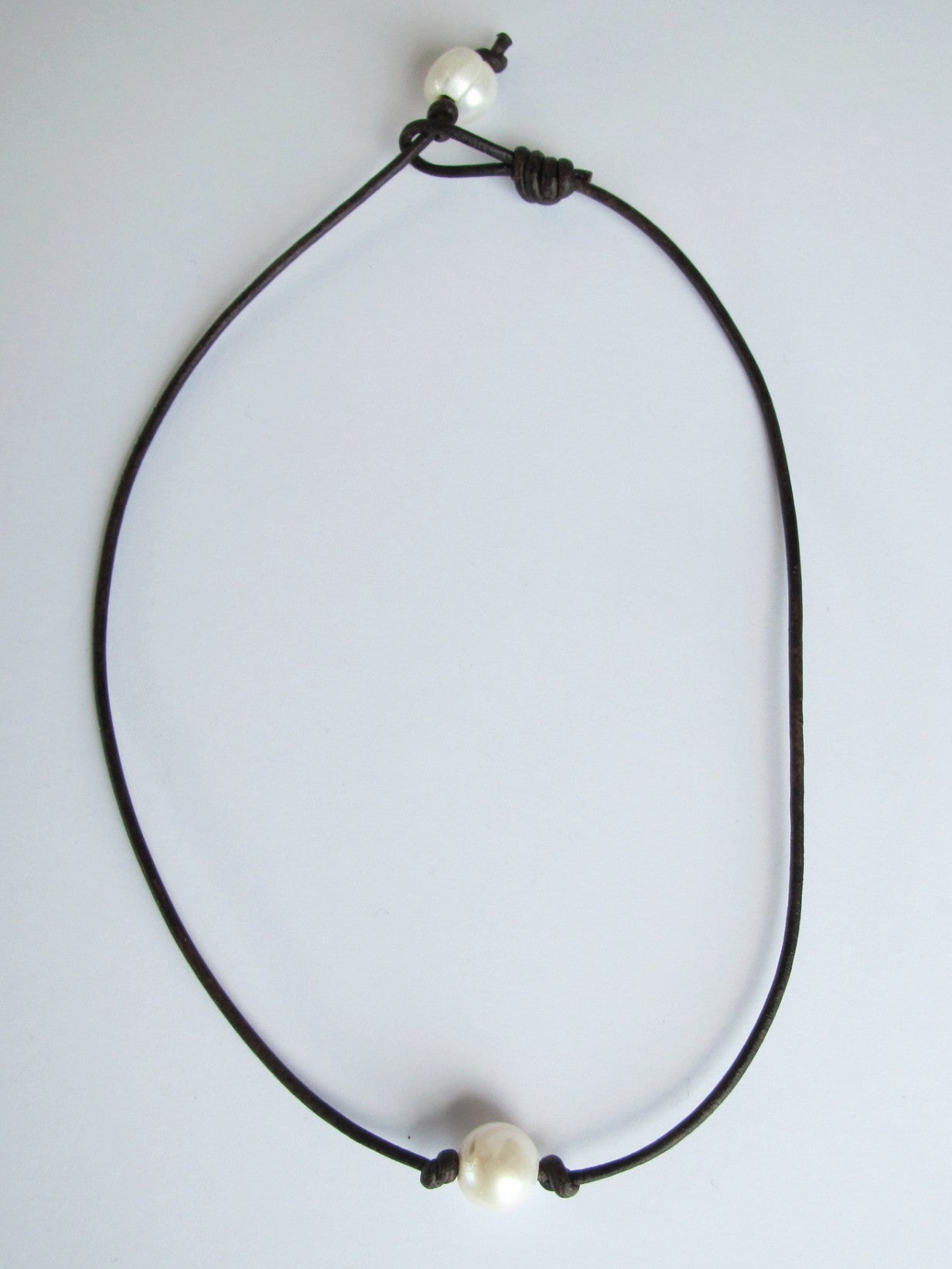 pearl single cord on store leather the necklace