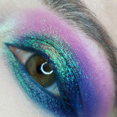 teal green blue pink and purple shimmer eyeshadow look