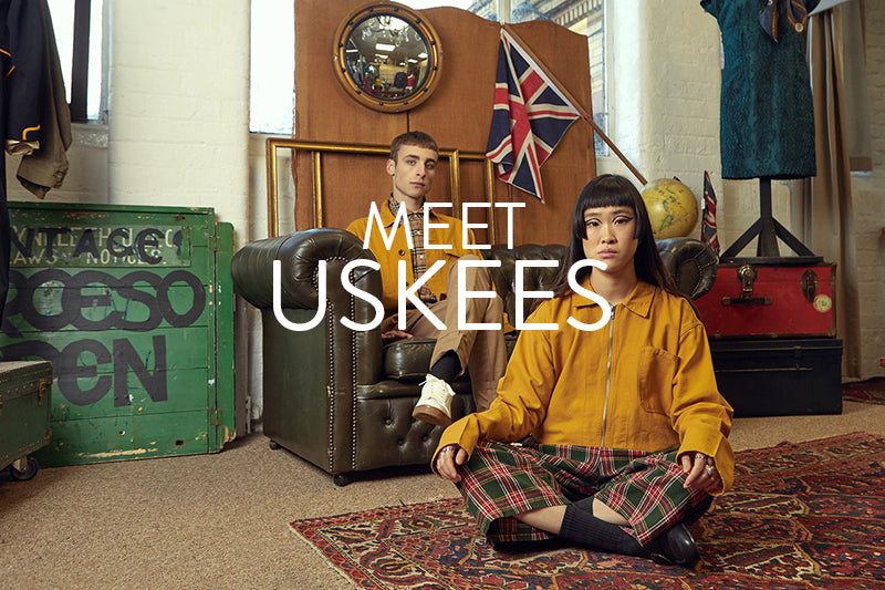 Uskees 2020 signature look with man and woman wearing Uskees gold coloured overshirt and jacket.