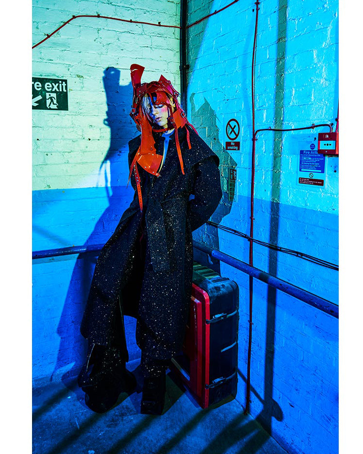 Jivomir Domoustchiev orange repurposed headpiece over black glitter coat