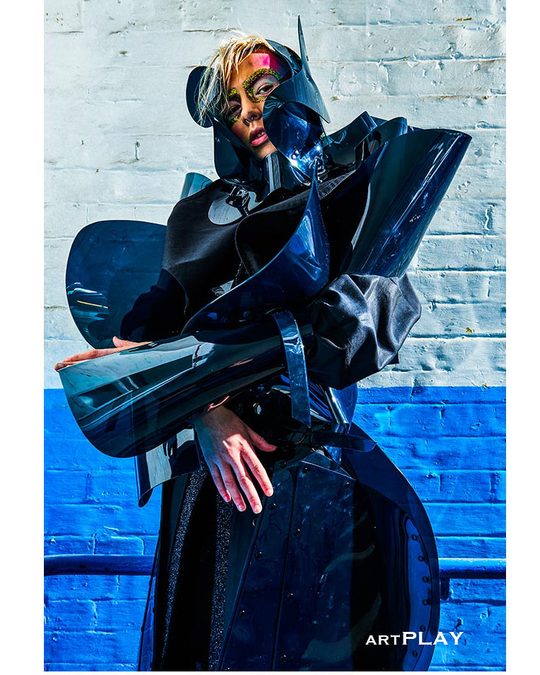 Jivomir Domoustchiev full teal sculpture jacket and spurt matched with repurposed headpiece over glitter cotton coat