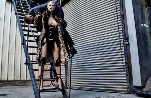 Lara Stone wears Jivomir Domoustchiev skirt and knee pads styled by Patti Wilson photos by Steven Klein for Vogue Italia