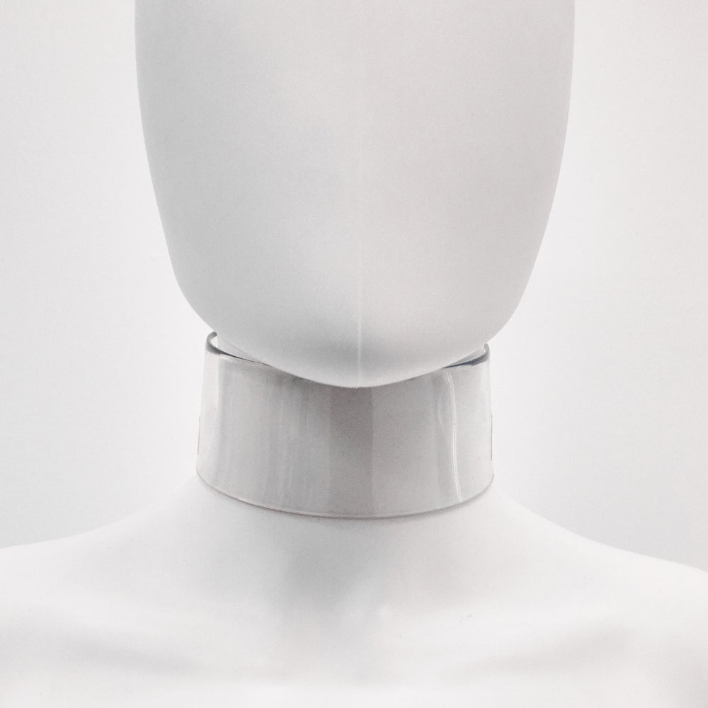 Jivomir Domoustchiev iconic vinyl chocker as seen in the Year and Years Sanctify video. available in a variety of colours. Simple yet striking adjustable for comfort. Finished with silver look studding & buckle. Complements any outfit.