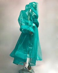 "The 'Onna Bugeisha"" Collection SuperSized stiffened net coat looks stunning over or under  any of our vegan vinyl sculpture pieces or warn over any cloths even by itself. Even as a dress.   Main features are 2 oversized pockets with extra long sleeves, a shawl neck that acts as a hood and padded belt. Make a visual statement everywhere you go.  Available in a variety of stunning both neon and monochrome colours and hand crafted to order as with the rest of our collection in our east London atelier."