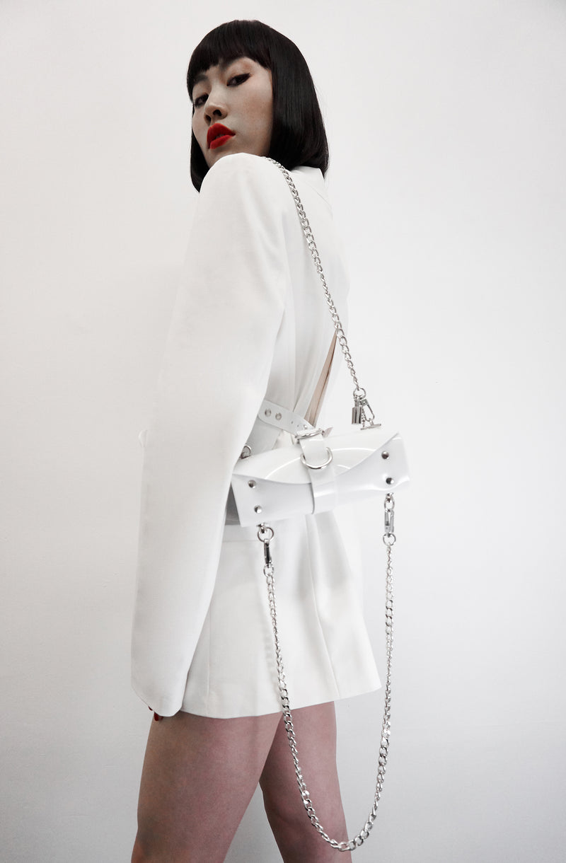 products/Jivomir_Domoustchiev_white_vinyl_studded_chain_bag_f550a95d-57dc-42df-96a8-59ffaaebcdfa.jpg