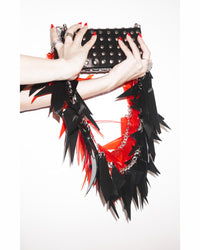 Jivomir Domoustchiev vegan vinyl triangular studded purse handbag hand custom crafted to order in London repurposed tassel chain