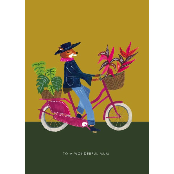 "Greeting card, with an illustration of a fox character riding a bicycle, with plants in the baskets and text that reads ""To a Wonderful Mum"""