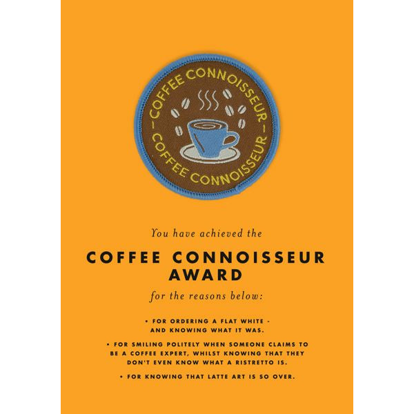 "Image is of a yellow greeting card with a brown iron-on patch attached. The patch says ""Coffee Connoisseur"" and has an image of a blue coffee cup with coffee beans."