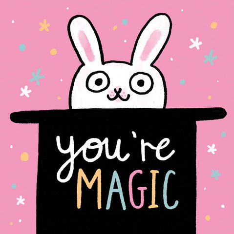 "Image is of a bright pink card with an illustration of a white rabbit peeking out of a black top hat, with the text ""you're magic""."