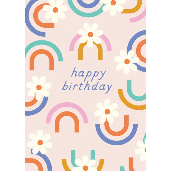 "Image is of a pale pink greeting card, covered with minimalist rainbow and daisy illustrations, with ""happy birthday"" written in blue."